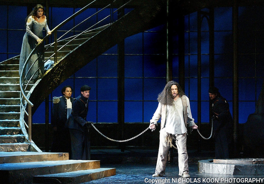 2003 - SALOME - (L to R) Salome (Turid Karlsen) watches as John the Baptist (Christopher Robertson) is brought out of the cistern in Opera Pacific's production of Salome.