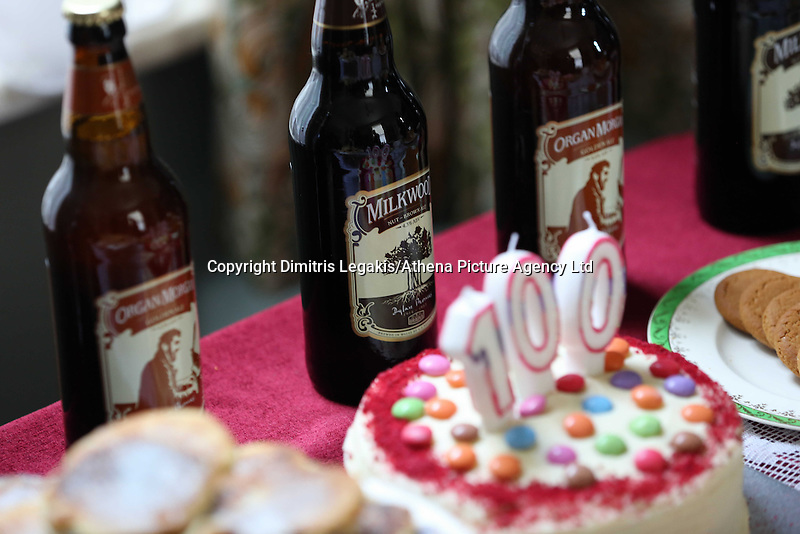 Swansea, UK. Saturday 25 October 2014<br /> Pictured: Milkwood ale and a birthday cake for an afternoon tea at Dylan Thomas' birth place.<br /> Re: Dylan Thomas birthday centenary celebrations at his birthplace, 5 Cwmdonkin Drive, Swansea, south Wales.
