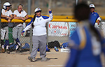 Western Nevada College head coach Leah Wentworth signals from third during a college softball game against Salt Lake Community College on Friday, Feb. 15, 2013, in Carson City, Nev. SLCC won the opener 4-2..Photo by Cathleen Allison