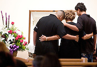 Family and friends stand next to Veronica Celis's casket during her wake. The day after giving birth, she was taken off life support. Aaron wanted to wait until the next day so that his daughter would not grow up sharing her birthday with the day her mother died. He named his daughter Veronica Destiny Celis after her mother. (Pat Shannahan/ The Arizona Republic)