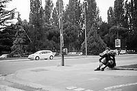 Life on the road: Nicolas Roche (IRL/SKY) on the phone on the curb in front of the team hotel in Burgos before leaving for the stage (he will eventually win many hours later...)<br /> <br /> stage 18: Roa - Riaza (204km)<br /> 2015 Vuelta &agrave; Espana