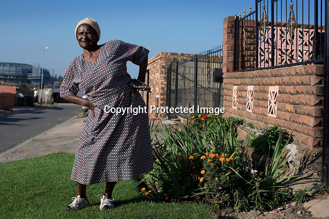 SOWETO, SOUTH AFRICA MARCH 23: Dorcas M Phamlane, age 84, exercises outside her house on March 23, 2014 in Orlando West, section of Soweto, South Africa. Dorcas exercise almost daily, either on her own or with another group of pensioners in a nearby park. The residents of Soweto has seen massive investment such as shopping malls, parks, outdoor gyms in the township. Soweto today is a mix of old housing and newly constructed townhouses. The population in Soweto is estimated to be around one million people. A new hungry black middle-class is growing steadily. Many residents work in Johannesburg but the last years many shopping malls have been built, and people are starting to spend their money in Soweto (Photo by: Per-Anders Pettersson)