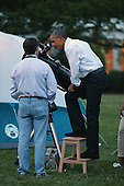 United States President Barack Obama looks through a telescope while hosting a group of Girl Scouts for an overnight campout at the White House June 30, 2015 in Washington, DC. The president and first lady Michelle Obama hosted the event as part of the first lady's Let's Move! Outside initiative and for Girl Scouts to earn the new Girls' Choice Outdoor badge.<br /> Credit: Chip Somodevilla / Pool via CNP