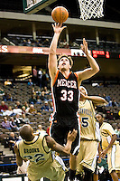 January 9, 2009:     Mercer forward Daniel Emerson (33) goes up for a shot while be guarded by Jacksonville's Aric Brooks (22) and Marcus Allen (45) in Atlantic Sun Conference action between the Jacksonville Dolphins and the Mercer Bears at Veterans Memorial Arena in Jacksonville, Florida.  Jacksonville defeated Mercer 80-59.