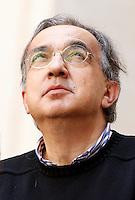 L'amministratore delegato della Fiat Sergio Marchionne durante la presentazione della nuova autovettura Fiat Jeep Renegade, a Palazzo Chigi, Roma, 25 luglio 2014.<br /> Fiat CEO Sergio Marchionne looks up during the presentation of the new Fiat's Jeep Renegade model car, at Chigi Palace, Rome, 25 July 2014.<br /> UPDATE IMAGES PRESS/Riccardo De Luca