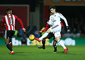 2nd December 2017, Griffen Park, Brentford, London; EFL Championship football, Brentford versus Fulham; Rui Fonte of Fulham in action with Josh Clarke and Ollie Watkins of Brentford
