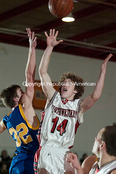 TORRINGTON--12 January 07--011208TJ03 - Northwestern's Brian Terwilliger (14) sends up a shot as Gilbert's Zac Tuozzo (32) defends during The Gilbert School's 55-53 win against Northwestern Regional High School at Torrington High School on Saturday, January 12, 2008. (T.J. Kirkpatrick/Republican-American)