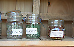 Garden herbs catnip, parsley, red chili peppers in mason jars