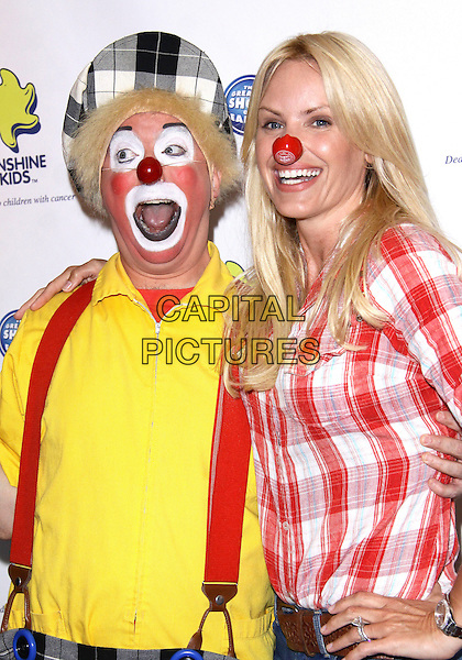 "GENA LEE NOLIN.Ringling Bros And Barnum & Bailey  presents ""Barnum's FUNundrum""  held at the Staples Center, Los Angeles, California, USA..July 15th, 2010.half length white red check plaid shirt hand on hip clown costume yellow make-up suspenders braces mouth open red nose funny.CAP/ADM/TC.©T. Conrad/AdMedia/Capital Pictures."