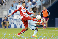 FC Dallas defender Hernan Pertuz (13) clears the ball from Kei Kamara Sporting KC... Sporting KC defeated FC Dallas 2-1 at LIVESTRONG Sporting Park, Kansas City, Kansas.