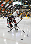 27 January 2012: University of Vermont Catamount forward Sebastian Stalberg, a Junior from Gothenburg, Sweden, checks Northeastern University Husky forward Braden Pimm, a Sophomore from Fort St. John, British Columbia, during a game at Gutterson Fieldhouse in Burlington, Vermont. The Catamounts fell to the Huskies 8-3 in the first game of their 2-game Hockey East weekend series. Mandatory Credit: Ed Wolfstein Photo