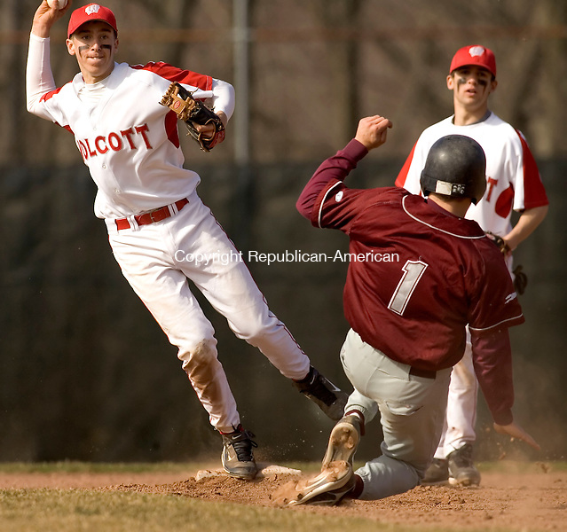 WOLCOTT, CT- 19 APRIL 2007-041907JS08-Wolcott's Ryan Pelletier tries to turn a double-play after getting Naugatuck's Brant Fox in a force play at secong during their game Thursday at Wolcott High School.-- --Jim Shannon / Republican-American