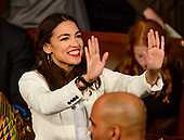 United States Representative Alexandria Ocasio-Cortez (Democrat of New York) signals to someone in the gallery as the 116th Congress convenes for its opening session in the US House Chamber of the US Capitol in Washington, DC on Thursday, January 3, 2019.<br /> Credit: Ron Sachs / CNP<br /> (RESTRICTION: NO New York or New Jersey Newspapers or newspapers within a 75 mile radius of New York City)