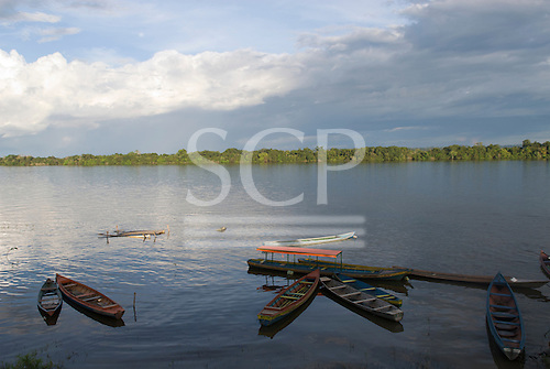 Altamira, Brazil. Frontier town on the Xingu river. Xingu river view at dusk with wooden voadeiras.
