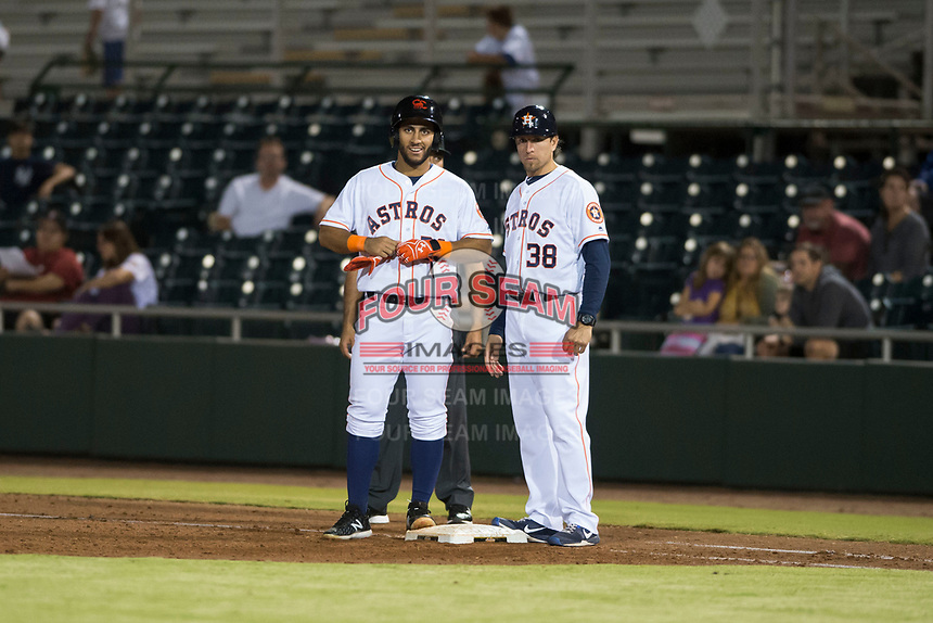 Scottsdale Scorpions designated hitter Abraham Toro-Hernandez (28) and hitting coach Troy Snitker (38), both of the Houston Astros organization, during an Arizona Fall League game against the Salt River Rafters at Scottsdale Stadium on October 12, 2018 in Scottsdale, Arizona. Scottsdale defeated Salt River 6-2. (Zachary Lucy/Four Seam Images)