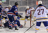 Danny Gare (18) watches as the puck goes in the net along with goal scorer Derek Smith (19), Jim Wiemer (18), Brad May (27), and goalie Tom Askey (35) during The Frozen Frontier Buffalo Sabres vs. Rochester Amerks Alumni Game at Frontier Field on December 15, 2013 in Rochester, New York.  (Copyright Mike Janes Photography)