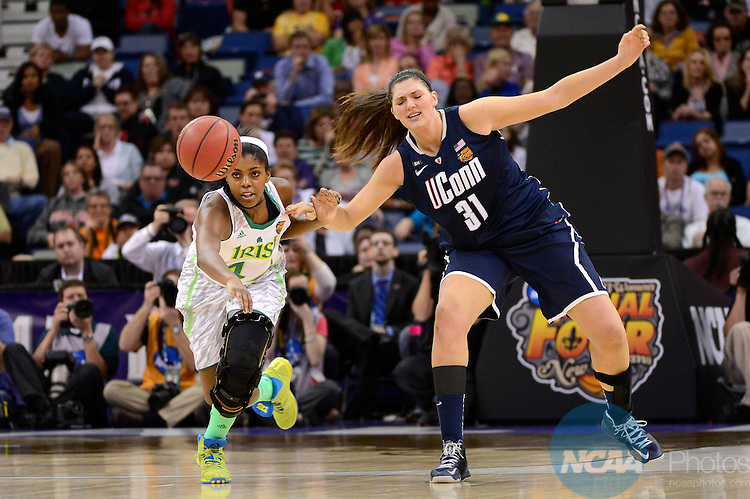 07 APR 2013:  Stefanie Dolson (31) of the University of Connecticut and Ariel Braker (44) of the University of Notre Dame chase after a loose ball during the Division I Women's Basketball Championship in New Orleans, LA.  Jamie Schwaberow/NCAA Photos