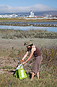 "Picking up trash in the wetlands at Bayfront Park. Volunteers in the City of Millbrae participated in California Coastal Cleanup Day on 9/19/09. Participants cleaned up inland locations throughout the city as well as at Bayfront Park on the San Francisco Bay shoreline. The inland cleanup efforts were important because, according to the California Coastal Commission, ""past Coastal Cleanup Day data tell us that most (between 60-80 percent) of the debris on our beaches and shorelines comes from inland sources, traveling through storm drains or creeks out to the beaches and ocean. Rain or even something as simple as hosing down a sidewalk can wash cigarette butts, bits of styrofoam, pesticides, and oil into the storm drains and out to the ocean."" The California Coastal Cleanup Day (http://www.coastal.ca.gov/publiced/ccd/ccd.html) is sponsored by the California Coastal Commission and is a part of the International Coastal Cleanup organized by The Ocean Conservancy."