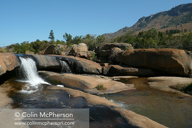 A waterfall in Pine Valley on the edge of the Drakensberg mountains, north of Mbabane, Swaziland. The Kingdom of Swaziland (population 1.1m), a small, landlocked country in southern Africa was bordered by South Africa on three sides and Mozambique to the east, with Mbabane as its administrative capital. At the start of the 21st century, the country had the highest incidence per head of population of HIV/Aids in the world and and high levels of poverty mainly in rural areas where 75 per cent of the population lived.