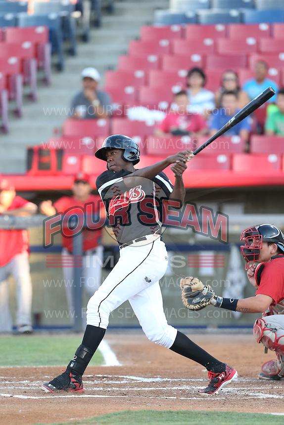 Gabriel Guerrero #22 of the Visalia Rawhide bats against the High Desert Mavericks at Heritage Field on July 19, 2014 in Adelanto, California. Visalia defeated High Desert, 10-9. (Larry Goren/Four Seam Images)