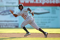 Connecticut Tigers outfielder P.J. Polk (15) during a double header vs. the Batavia Muckdogs at Dwyer Stadium in Batavia, New York July 10, 2010.  Connecticut dropped the first game 3-5 then defeated Batavia 8-1 in the night cap.  Photo By Mike Janes/Four Seam Images