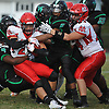 John Mercado #20 of Center Moriches, left, battles for a rushing gain during a Suffolk County Division IV varsity football game against host Wyandanch High School on Thursday, Sept. 7, 2017.