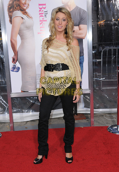 "VIENNA GIRADI.at the CBS Films' L.A. Premiere of ""The Back-Up Plan"" held at The Village Theatre in Westwood, California, USA, April 21st, 2010..arrivals full length gold beige crochet top black trousers waist belt peep toe shoes .CAP/RKE/DVS.©DVS/RockinExposures/Capital Pictures."