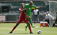 Aurelien Capoue (10) battles for the ball against Gabriel Gomez (6). Guadeloupe defeated Panama 2-1 during the First Round of the 2009 CONCACAF Gold Cup at Oakland Coliseum in Oakland, California on July 4, 2009.