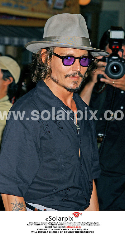 ALL ROUND PICTURES FROM SOLARPIX.COM.*MUST CREDIT SOLARPIX.COM OR DOUBLE FEE WILL BE CHARGED*.**NOT FOR SYNDICATION IN FRANCE**.The premiere of the film 'PIRATES OF THE CARIBBEAN' at the Disneyland Theatre in Anaheim in California in the USA. on June 24, 2006..This pic: Johnny Depp arrives at the premiere.JOB REF:2524-GLS.DATE. 26.06.06
