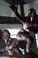 (Sept. 2, 1999, Columbus, Ohio)  Archie Griffin stands behind the two Heisman trophys he won in 1974 and 75 OSU football seasons.  He is the only two time winner of the trophy. This is the 25th anniversary of that accomplishment. Photo taken at Hall of Fame Room in the Shottenstein Center at OSU. (Columbus Dispatch photo by Tim Revell)