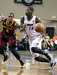 SIOUX FALLS, SD - FEBRUARY 11:  DeAndre Liggins #14 from the Sioux Falls Skyforce drives against Gilbert Brown #4 from the Canton Charge in the first quarter of their game Tuesday night at the Sanford Pentagon. (Photo by Dave Eggen/Inertia)