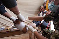Doctors give treatment to an earthquake victim in Sindhupalchok, outskirt of Kathmandu, Nepal. May 1, 2015