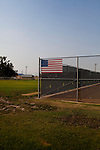 An American flag is seen on the tennis courts outside of the Whitehall High School in Whitehall, Montana August 23, 2011. Whitehall's population was just over 1,000 in the 2000 census.