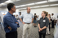 "Robert Bogue '17 talks about ""Flux and Isotope Analysis of CO2 emissions in Mammoth"" with President Jonathan Veitch and Interim VP for Academic Affairs and Dean of the College Kerry Thompson<br /> Occidental College's Undergraduate Research Center hosts their annual Summer Research Conference on Aug. 4, 2016. Student researchers presented their work as either oral or poster presentations at the final conference. The program lasts 10 weeks and involves independent research in all departments.<br /> (Photo by Marc Campos, Occidental College Photographer)"