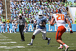19 September 2015: UNC's Elijah Hood (34) and Illinois' Clayton Fejedelem (20). The University of North Carolina Tar Heels hosted the University of Illinois Fighting Illini at Kenan Memorial Stadium in Chapel Hill, North Carolina in a 2015 NCAA Division I College Football game. UNC won the game 48-14.