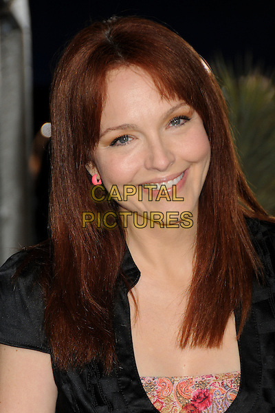"AMY YASBECK.The L.A. Premiere of ""Rango"" held at The Regency Village Theatre in Westwood, California, USA, .February 14th 2011.headshot portrait black pink smiling  .CAP/ADM/BP.©Byron Purvis/AdMedia/Capital Pictures."