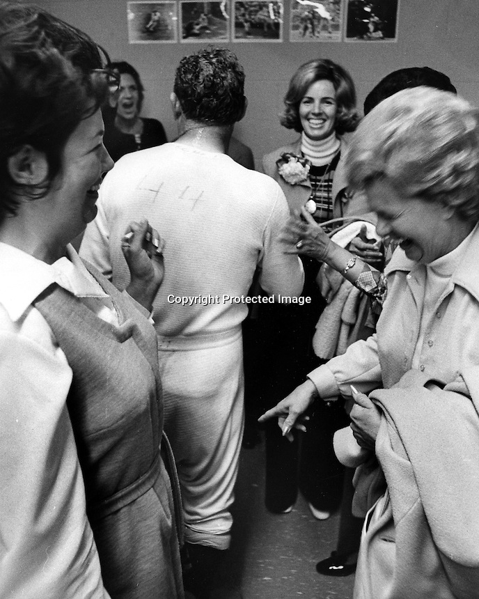 Oakland Athletics wives & relatives viewing the long underware of A's coach Verh Hoscheit in dressing in Cincinnati following the A's victory over the Reds in the 1972 Series. (photo/Ron Riesterer)