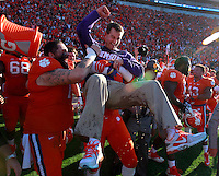 Clemson head coach Dabo Swinney celebrates with members of his team after the Tigers defeated South Carolina 35-17 at Memorial Stadium on Saturday.