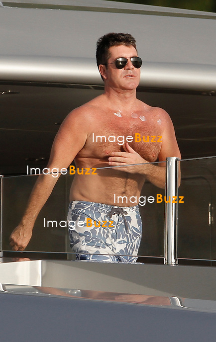 SIMON COWELLTRAVES TO ST. BARTHS ON A 382,000 EUROS A WEEK SLIPSTREAM SUPERYACHT - /January 5, 2013 - X Factor mogul Simon Cowell has been making the rounds of the best vacation spots this holiday season aboard the ultra-luxe Slipstream superyacht. Cowell and his fiancé Mezhgan Hussainy celebrated New Year's Eve at the posh Sandy Lane Resort in Barbados, where Rihanna performed at a lavish bash on the big night. .From there, the pair took the sleek yacht to St. Barts, the scene of Russian billionaire Roman Abramovich's own extravagant New Year's party. Though not the largest vessel moored in St. Bart's ? that would be Abramovich's Eclipse yacht at 557 feet ? Cowell's craft was still quite attractive and impressive..The 196-foot Slipstream, which costs the TV tycoon over $500,000 a week to charter, can accommodate 12 guests plus a crew of 14 and features mirrors above a giant waterbed, a Jacuzzi, an observation lounge with panoramic views, gym and a sky lounge with a retractable roof. Launched by France's CMN Shipyard, the yacht's décor is done in a modernized Art Deco style combining dark ebony woodwork and red leather paneling. .The sun deck features a spa, sun-pads, bar with BBQ and al fresco dining area, and the yacht comes equipped with a cutting edge home entertainment system including video on demand as well as a satellite communications center.