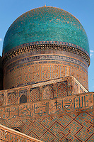 Low angle view of blue dome of main building, Bibi-Khanym Mosque, 15th century, Samarkand, Uzbekistan, pictured on July 17, 2010, in the afternoon. Named after the wife of Amir Timur, 14th century ruler, the mosque was constructed following his 1399 Indian campaign. It collapsed after an earthquake in 1897 and was restored in the late 20th century. Samarkand, a city on the Silk Road, founded as Afrosiab in the 7th century BC, is a meeting point for the world's cultures. Its most important development was in the Timurid period, 14th to 15th centuries. Picture by Manuel Cohen.