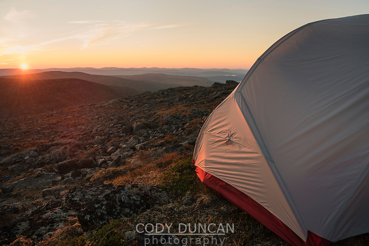 Tent at sunrise from mountain camp on Skierfe, Sarek National Park, Lapland, Sweden
