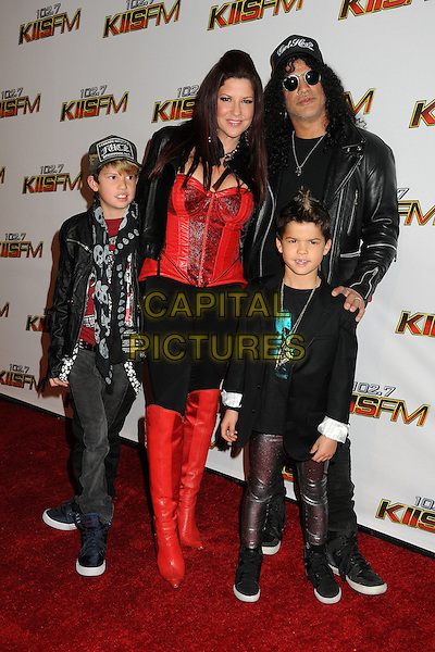 Perla Hudson & Slash (Saul Hudson).The 102.7 KIIS FM Jingle Ball 2011 arrivals held at The Nokia Theater Live in Los Angeles, California, USA, December 3rd 2011..full length black sunglasses shades married husband wife red boots corset kids children.CAP/ADM/BP.©Byron Purvis/AdMedia/Capital Pictures.