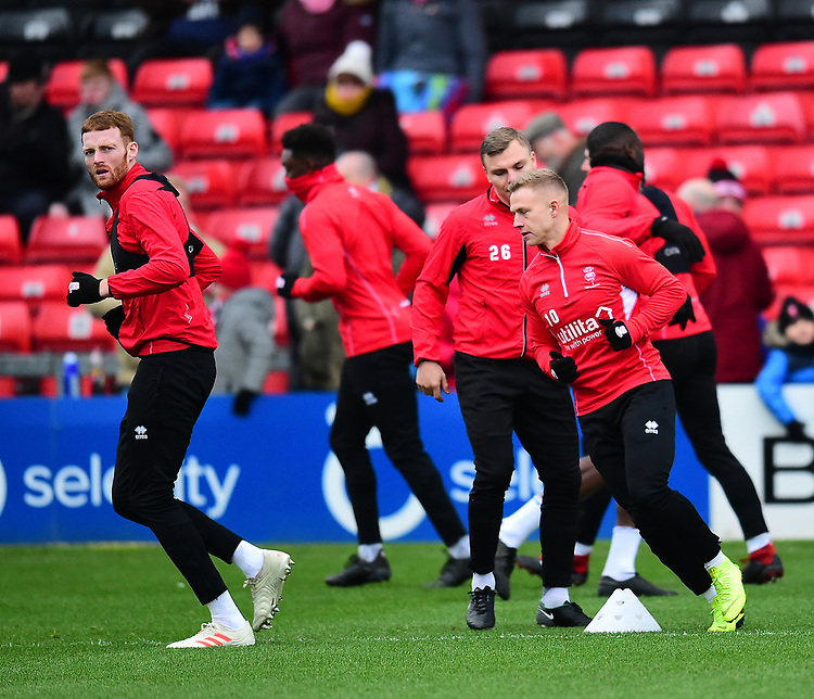 Lincoln City's Cian Bolger, left, and Danny Rowe during the pre-match warm-up<br /> <br /> Photographer Andrew Vaughan/CameraSport<br /> <br /> The EFL Sky Bet League Two - Lincoln City v Grimsby Town - Saturday 19 January 2019 - Sincil Bank - Lincoln<br /> <br /> World Copyright © 2019 CameraSport. All rights reserved. 43 Linden Ave. Countesthorpe. Leicester. England. LE8 5PG - Tel: +44 (0) 116 277 4147 - admin@camerasport.com - www.camerasport.com