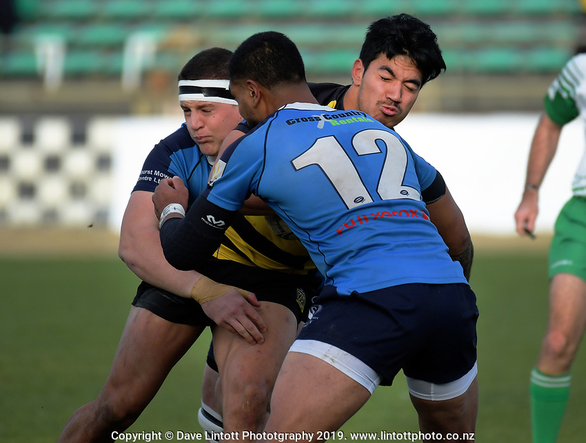 Carlos Ropoama-Third is tackled during the 2019 Manawatu premier club rugby Hankins Shield final match between Varsity and Feilding Yellows at CET Arena in Palmerston North, New Zealand on Saturday, 13 July 2019. Photo: Dave Lintott / lintottphoto.co.nz