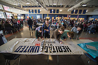 "NWA Democrat-Gazette/J.T. WAMPLER Students sign a banner Monday Feb. 13, 2017 at Rogers Heritage High School. The banner reads: ""Heritage United: We are one, divided by none."" Students were encouraged to sign their name and add a message on what unites them as opposed to what divides them."