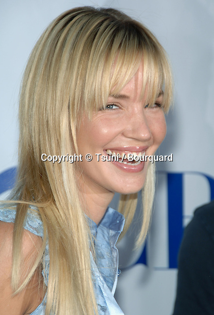 Ashley Scott arriving at the  CBS television Critic Assocoation Summer Party at the Rose Bowl in Los Angeles.<br /> eye contact<br /> headshot<br /> smile
