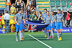 The Hague, Netherlands, June 09: Ball kids walk on the field with the flag of New Zealand before the field hockey group match (Women - Group A) between England and Argentina on June 9, 2014 during the World Cup 2014 at Kyocera Stadium in The Hague, Netherlands. Final score 0-0 (0-0)  (Photo by Dirk Markgraf / www.265-images.com) *** Local caption ***