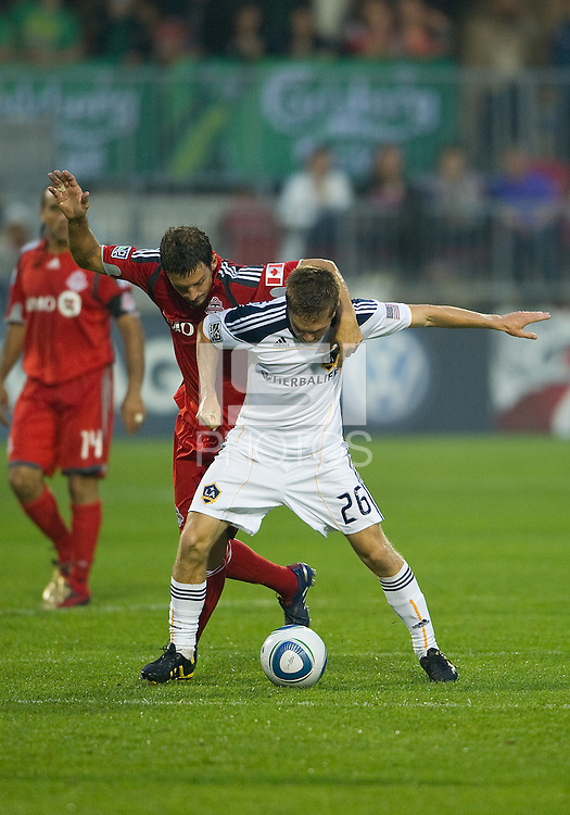 26 June 2010: Toronto FC midfielder Martin Saric #25 and Los Angeles Galaxy midfielder Michael Stephens #26 in action during a game between the Los Angeles Galaxy and the Toronto FC at BMO Field in Toronto..Final score was 0-0...