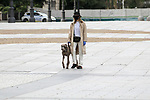 A woman walks her dog through the streets of Madrid during the health crisis due to the Covid-19 virus pandemic - Coronaviruss. April 26,2020. (ALTERPHOTOS/Alejandro de Dios)