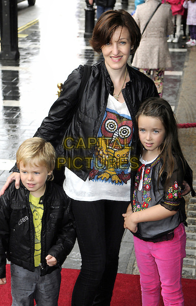 Kacey Ainsworth & her kids.The 'Nickelodeon's Dora the Explorer LIVE! Search for the City of Lost Toys' press performance, Apollo Theatre, Shaftesbury Avenue, London, England..August 29th, 2012.half 3/4 length black leather jacket white top print pink jeans denim grey gray trousers children family mother mom mum family .CAP/PP/BK.©Bob Kent/PP/Capital Pictures.